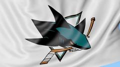 Close-up of waving flag with San Jose Sharks NHL hockey team logo, seamless loop Stock Footage