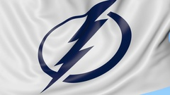 Close-up of waving flag with Tampa Bay Lightning NHL hockey team logo, seamless Stock Footage