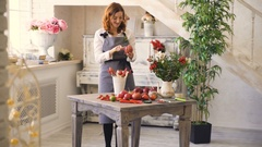 Chef woman and florist preparing fruits and vegetables for making fruit bouquet Stock Footage