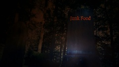 Pan of tombstone with Junk Food written on top concept death from Junk Food Stock Footage