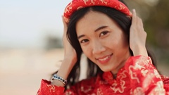Vietnam girl in the national costume and dress Ao Dai posing and smiling for the Stock Footage