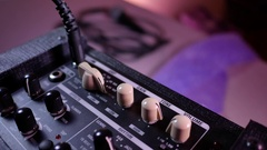Man's hand increases the volume on the guitar amp Stock Footage