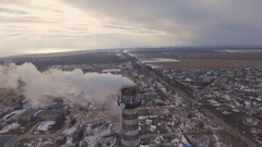 Top of the pipe with steam during the winter heating season (aerial shot). 4K Stock Footage