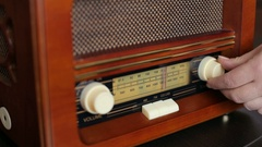 Hand tuning fm radio button. Vintage stereo and control button. Stock Footage