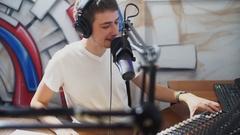 DJ on the radio station broadcasts live Stock Footage