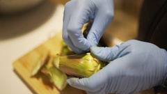 Chef preparing cooking artichokes on a wooden cutting board. Top point of view. Stock Footage