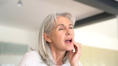 Senior woman with toothache Stock Footage