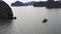 Stone cliffs into the sea near the coast of the Cat Ba Island in Cat Gia Bay Stock Footage