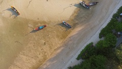 Long-tail boats in low water during low tide on the Rawai beach at Phuket Island Stock Footage