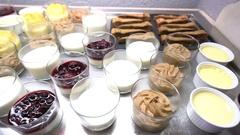 Closeup of delicatessen food set on restaurant buffet Stock Footage