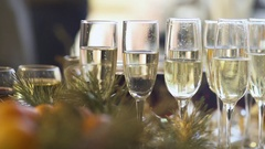Glasses of champagne, close-up. Camera movement. Blurred background. Stock Footage