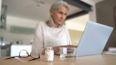 Senior woman taking pill to ease migraine Stock Footage