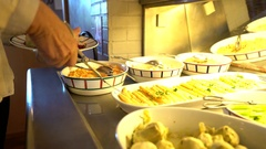People serving themselves in restaurant buffet Stock Footage