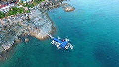 Inflatable motor boats parked at the pontoon pier. HD aerial shooting birds eye Stock Footage