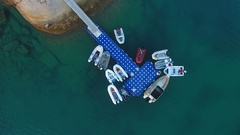 Inflatable motor boats parked at the pontoon pier. HD aerial shooting from above Stock Footage