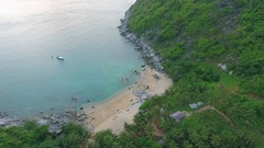 Paradise Nui beach with with stones, blue clear water and palm trees. Phuket Stock Footage