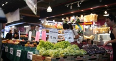 People Shopping at Fresh Fruit Stall in Lonsdale Quay Market, Vancouver Stock Footage