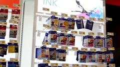 Pan shot of display cartridges for sale inside Best buy store Stock Footage