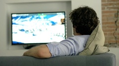 Man finishes watching television and turns it off Stock Footage