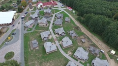 Aerial photo of village or town. High above houses set in green countryside. Stock Footage