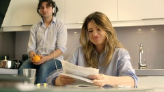 Irritated woman working on papers while her boyfriend listening music Stock Footage