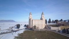 Aerial LDS Manti Utah Temple winter snow traffic 4K Stock Footage
