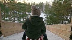Camera Following Boy Sledding in Winter Stock Footage