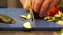 Macro Cook Hands Cut Zucchini to Thin Slices on Table Stock Footage