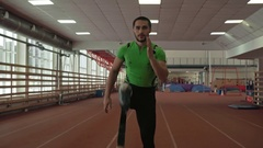 Professional Athlete with Prosthesis Beginning Run Stock Footage