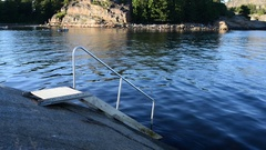 Metal stairs to the sea from a big rock Stock Footage