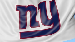 Close-up of waving flag with New York Giants NFL American football team logo Stock Footage