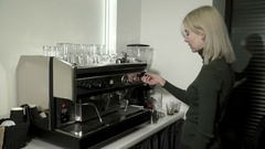 Slow motion, young woman making foam in milk with coffee machine Stock Footage