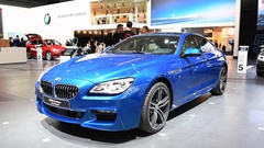 BMW M6 Gran Coupe in bright blue high performance sedan Stock Footage
