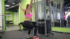 Young woman working her body at the gym. Making fitness exercise indoors. Stock Footage