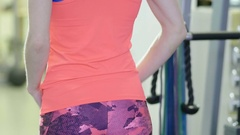 Girl tying hair in the hall to the fitness center before practice. Close-up Stock Footage