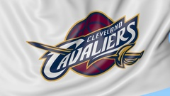 Close-up of waving flag with Cleveland Cavaliers NBA basketball team logo Stock Footage