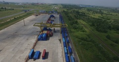Container unloading Low-altitude airplane helicopter view of cargo train Stock Footage