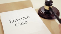 Divorce case  written on legal documents with gavel Stock Footage