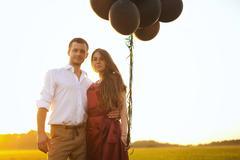 Honeymoon couple romantic in love at field sunrise Stock Photos