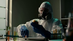 Biological well equipped laboratory. Elderly scientist in protective lab coat Stock Footage