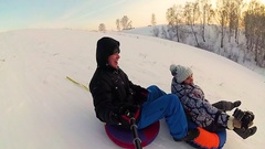 Happy family rides and smiling snowtube on snowy roads.slow motion. snow winter Stock Footage