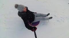 Happy girl rides and smiling snowtube on snowy roads.slow motion. snow winter Stock Footage