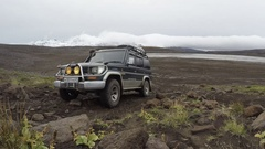 Off-road expedition Toyota Land Cruiser Prado driving on rocky mountain road Stock Footage