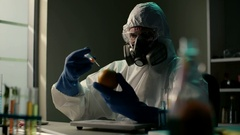Scientist in modern laboratory. GMO's citrus fruits. Biologist injects additive Stock Footage