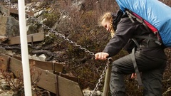Hiker walking Overland Track up steep incline Stock Footage