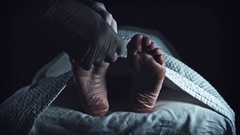 4K Morgue Dead Body, Mortician Place Unidentified Tag on Foot Stock Footage