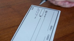 Writing a cheque for payment Stock Footage