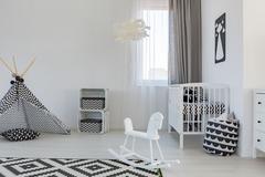 Baby room with crib Stock Photos