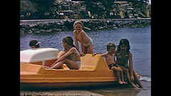 Ibiza children on pedal boat Stock Footage
