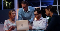 Businesspeople having discussion over laptop Stock Footage